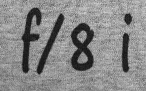 zbliżenie nadruku: f/8 i stań gdzie trzeba